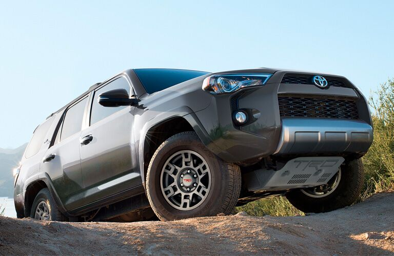2019 Toyota 4Runner exterior front fascia and passenger side on steep rock