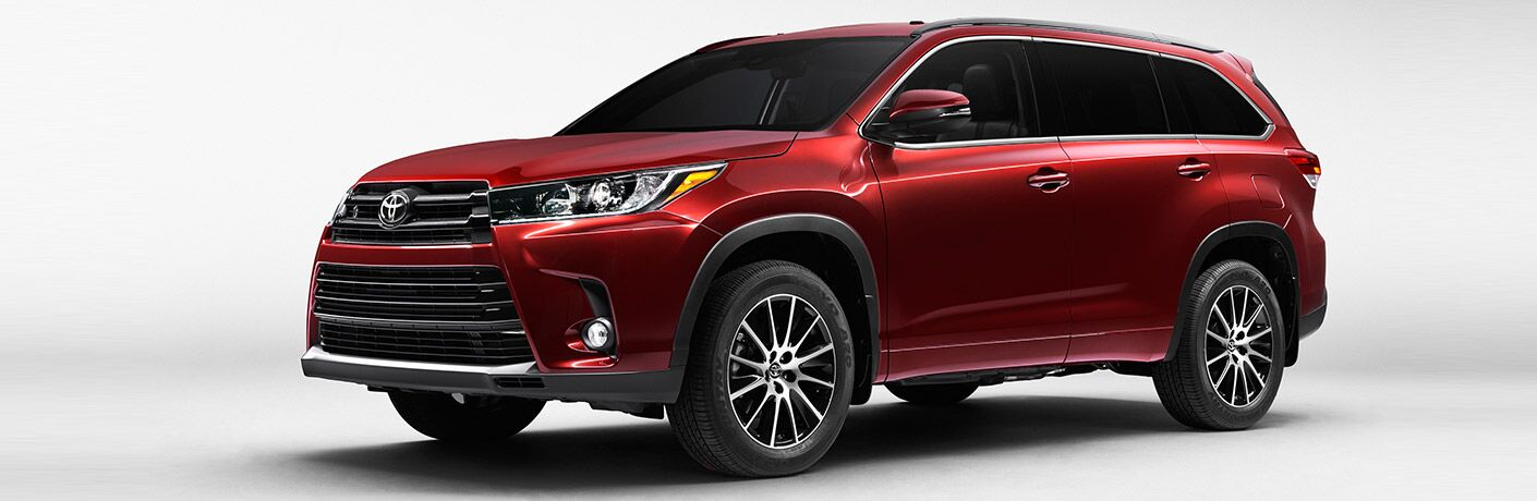 side profile of red 2017 Toyota Highlander on white background