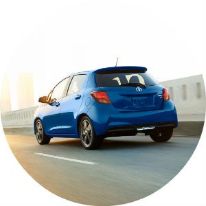blue 2017 Toyota Yaris driving on road