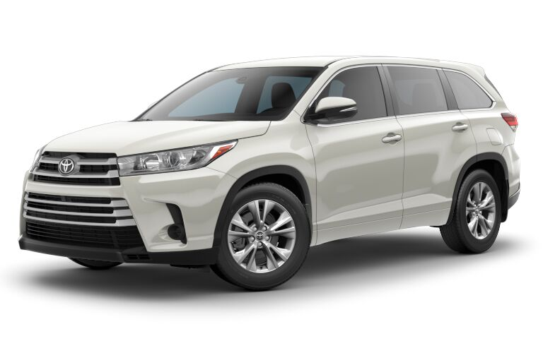 front side profile of white 2018 Toyota Highlander against white background