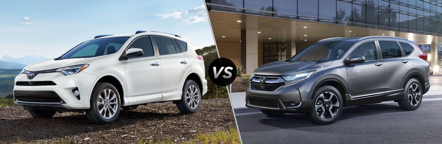white 2018 Toyota RAV4 set against gray 2018 Honda CR-V