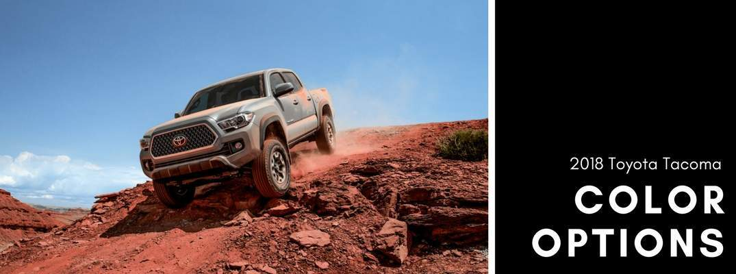 tan 2018 Toyota Tacoma driving down rocky decline next to color options wording