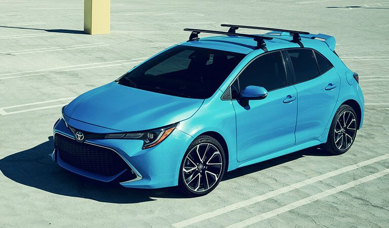 teal 2019 Toyota Corolla Hatchback parked in parking lot