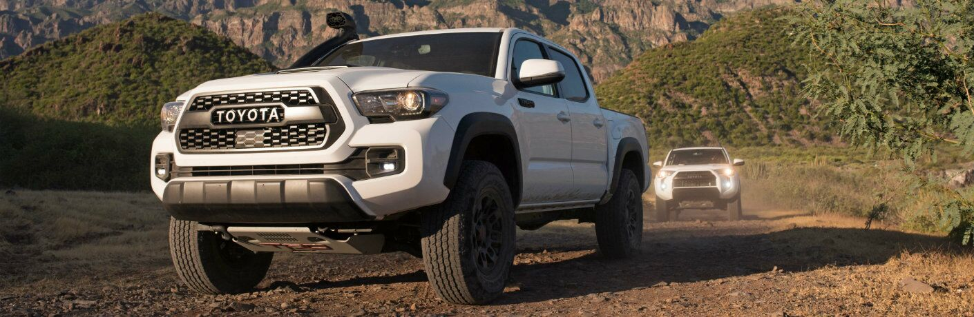 front view of white 2018 Toyota Tacoma TRD Pro travelling off road