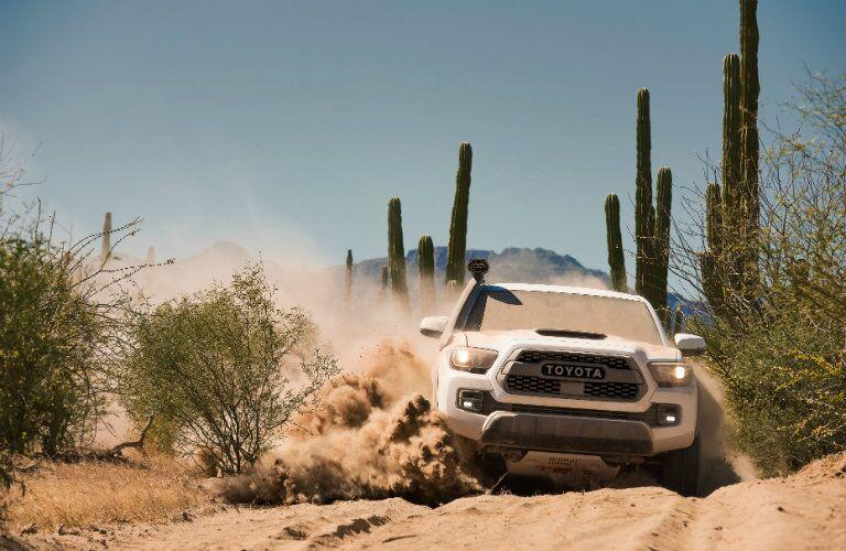 white 2018 Toyota Tacoma TRD Pro driving through sand