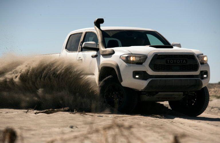 white 2018 Toyota Tacoma TRD Pro kicking up sand