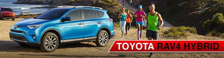blue 2017 Toyota RAV4 Hybrid with runners