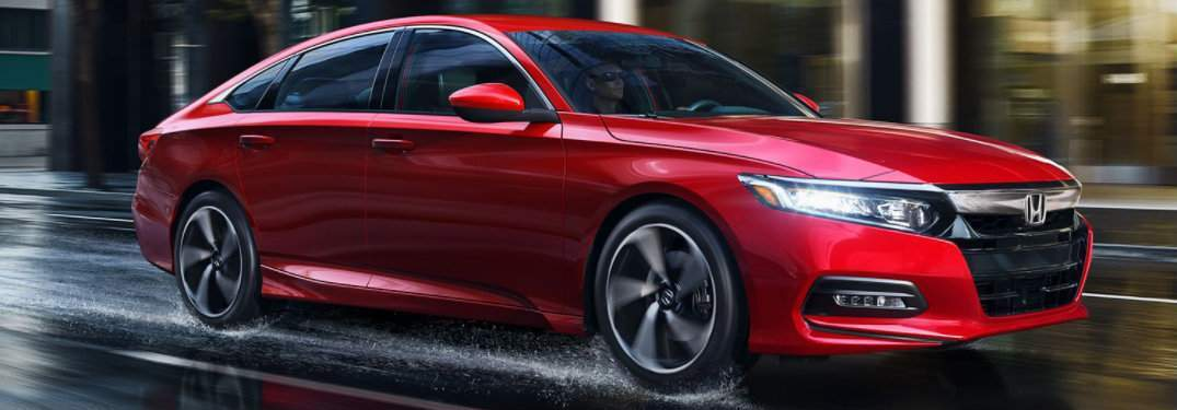 Red 2018 Honda Accord sedan driving in rain