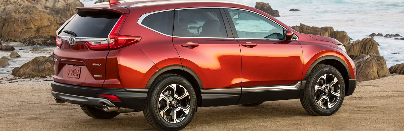 right side view of red honda cr-v