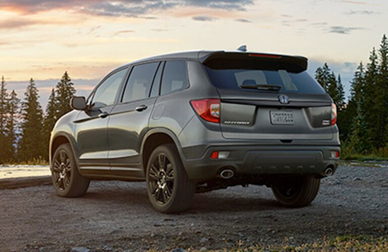 Rear driver side exterior view of a gray 2019 Honda Passport