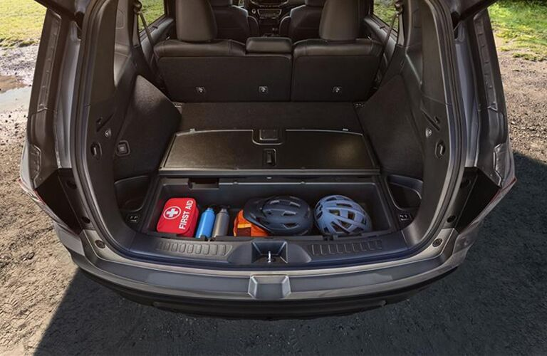 bike helmets and gear in back of honda passport