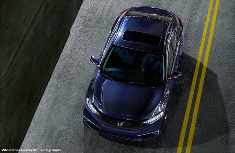 2020 Honda Civic Sedan Touring driving down a highway