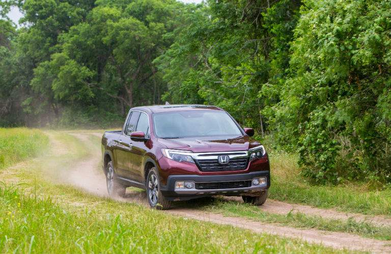 A front view photo of a 2018 Honda Ridgeline coming down a trail