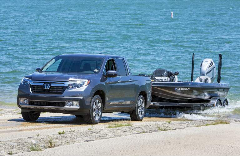 A photo of a 2018 Honda Ridgeline pulling a boat out of the water