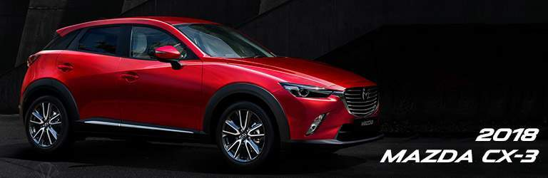 Red 2018 Mazda CX-3 in front of dark background