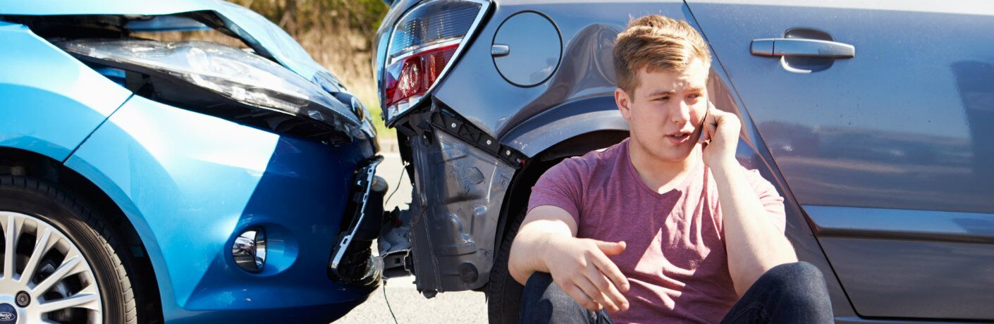 Young Man Sitting By Crash