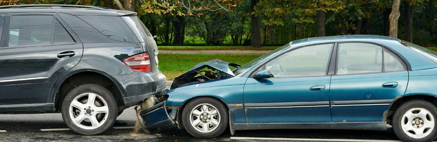 Blue car rear-ending van