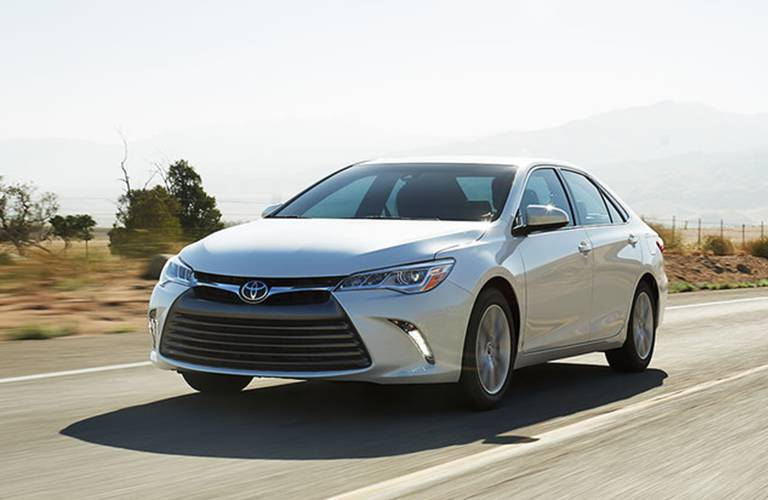Toyota Camry driving on road