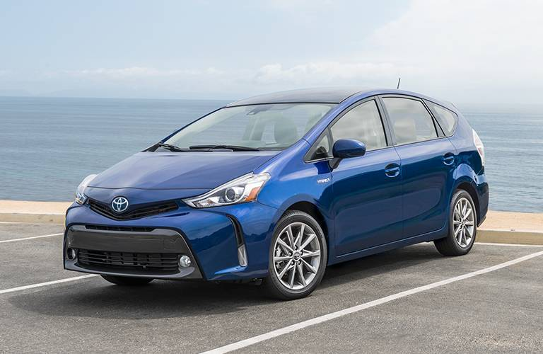 Toyota Prius V driving on a road