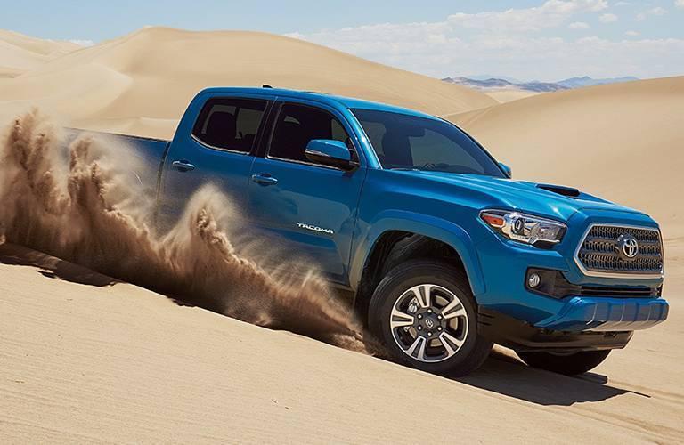 Toyota Tacoma driving on sand