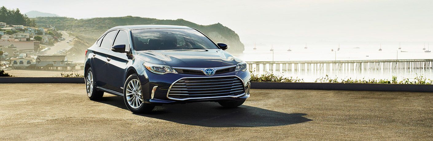 2018 toyota avalon hybrid overlooking town and ocean cliff