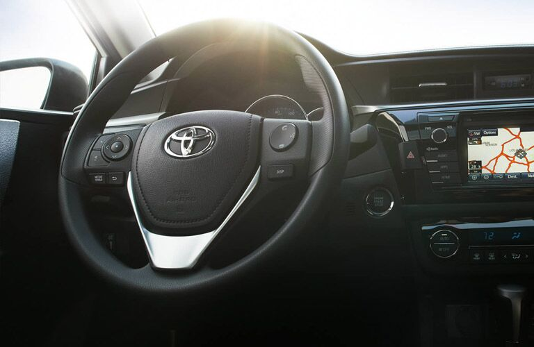Steering Wheel and Dash view of the 2017 Toyota Corolla
