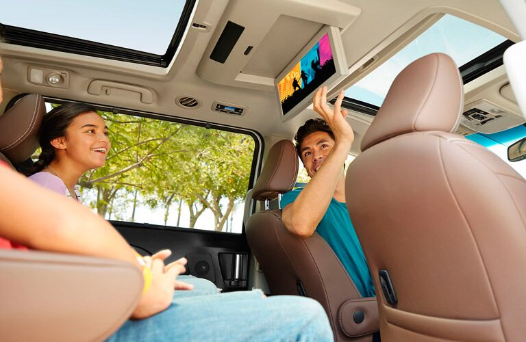Kids Sitting in the Back of a 2017 toyota Sienna looking at the Display Screen