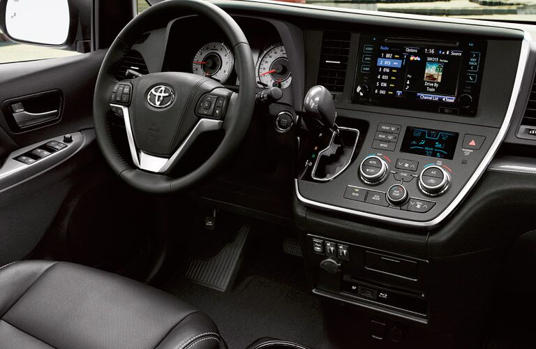 Interior View of the Dashboard and Steering Wheel in the 2017 Toyota Sienna in Black