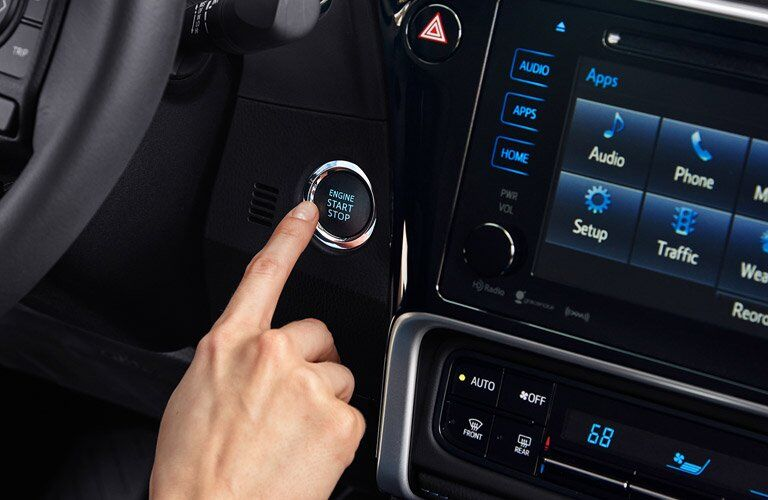 pressing the push button start of 2017 Toyota Corolla