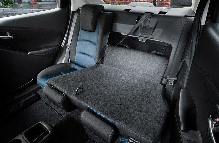 rear interior view with seat folded down of 2017 Yaris iA