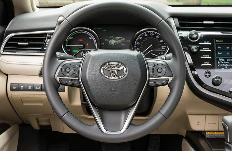 Steering wheel an driver info center of the 2018 Toyota Camry Hybrid