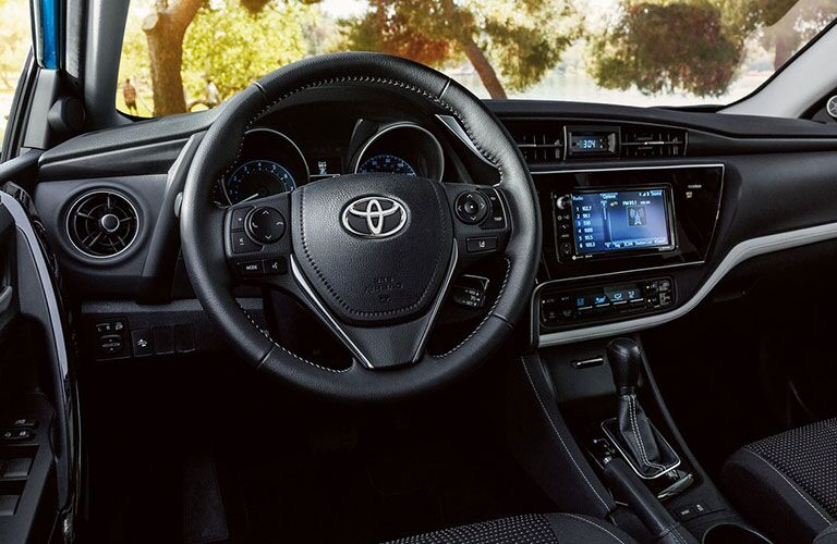 front interior of 2018 toyota corolla im including steering wheel and infotainment system