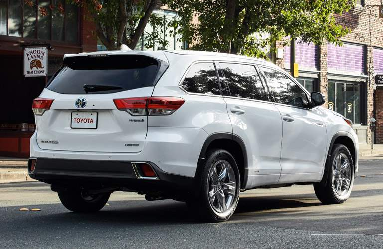 rear bumper and side view of white 2018 toyota highlander hybrid