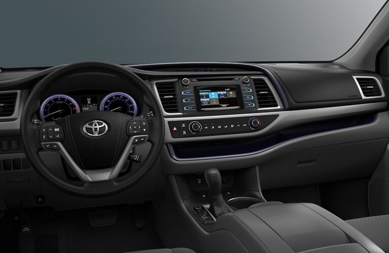 front interior of 2018 toyota highlander including steering wheel and infotainment sytem