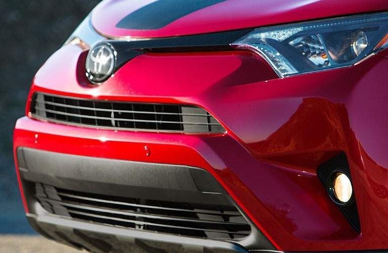 front grille and headlights of red 2018 toyota rav4