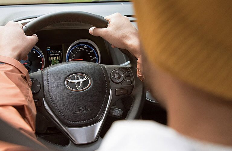 close up of steering wheel of 2018 toyota rav4 hybrid and dashboard