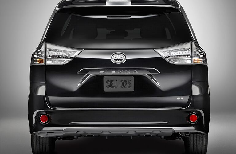 rear view of black 2018 toyota sienna against white background