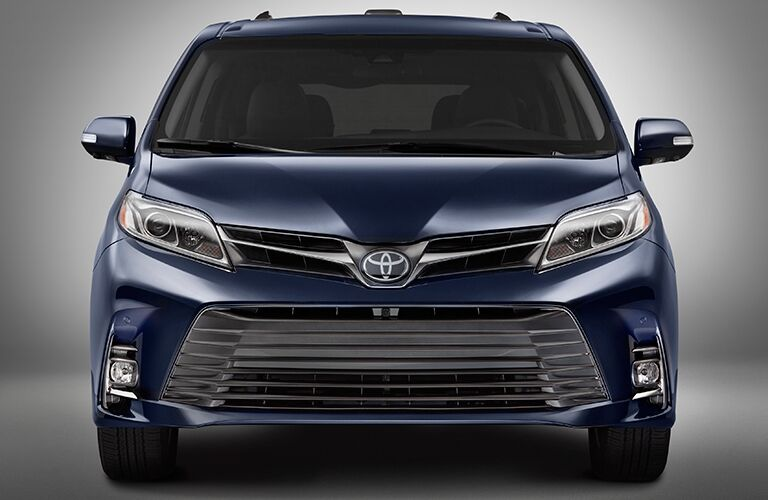 front view of blue 2018 toyota sienna against white background