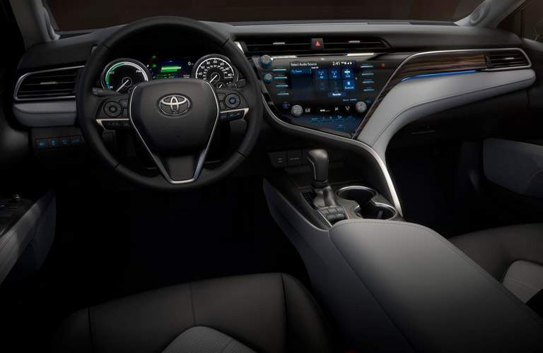 interior of 2018 toyota camry focusing on dashboard, center screen and steering wheel