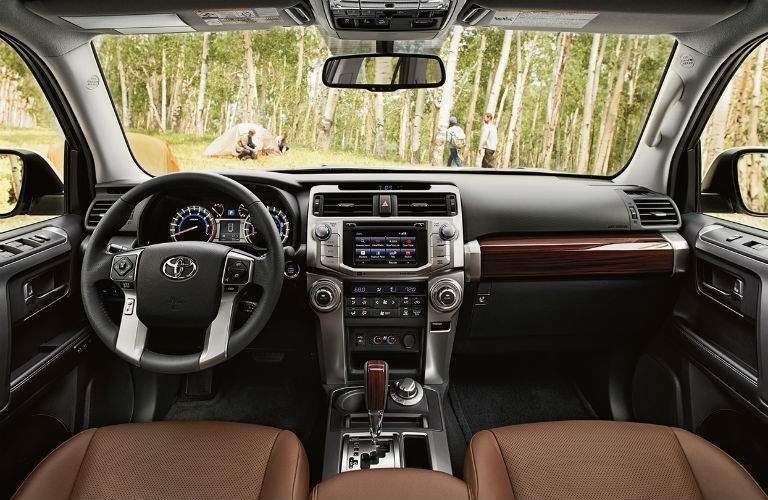 front interior of 2018 toyota 4runner including steering wheel, dashboard, and center infotainment system