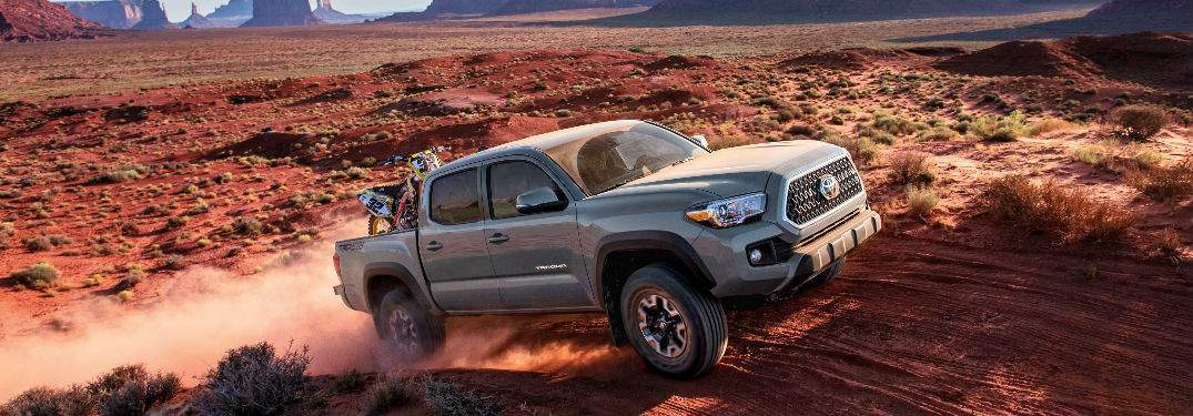 silver 2018 toyota tacoma scaling desert hill with full payload