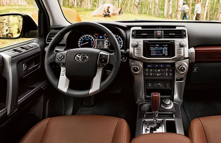 front interior of 2019 toyota 4runner including steering wheel and infotainment system