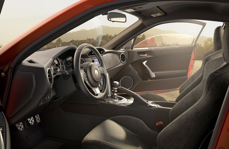 side view of front interior of 2019 toyota 86 including steering wheel and seating
