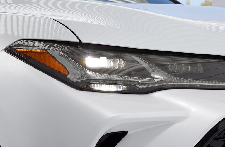 front headlamps of white 2019 toyota avalon
