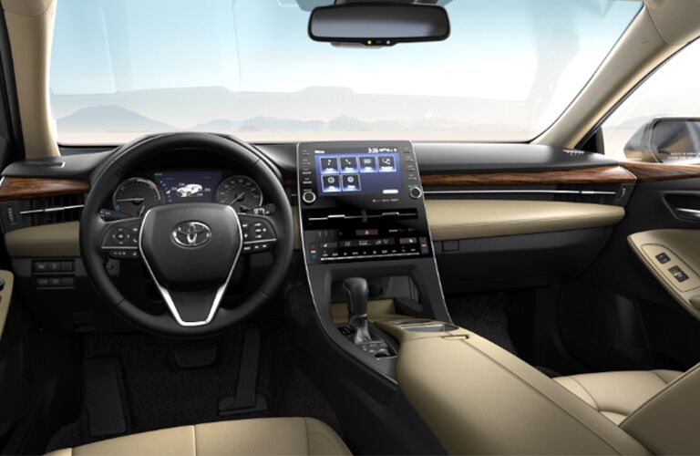 front interior of 2019 toyota avalon hybrid including steering wheel and center infotainment system