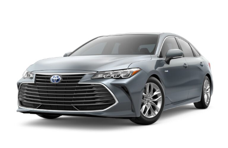 front and rear view of silver 2019 toyota avalon hybrid against white background