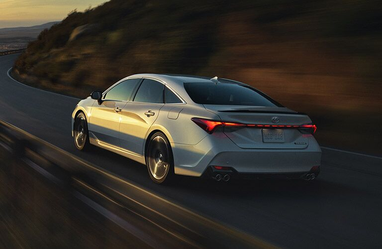 rear and side view of white 2019 toyota avalon