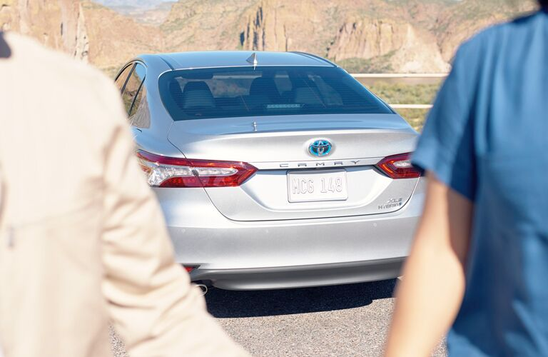 rear view of silver 2019 toyota camry hybrid