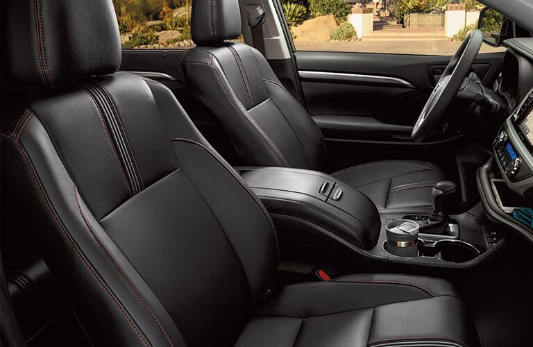 side view of front interior of 2019 toyota highlander including seats and center console