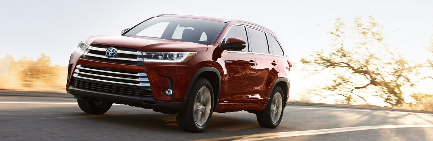front and side view of red 2019 toyota highlander hybrid